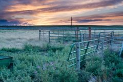 Sunset behind fencing in Eastern Plains Colorado Stock Photo