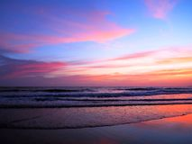 Pink and Purple Sunset over the Ocean Royalty Free Stock Images