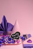 Pink and purple theme party table setting decorations - vertical. Stock Photo