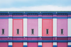 Pink and Purple Walls With Windows Stock Image