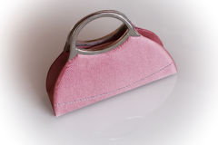 Pink purse. Small, luxury hand bag for woman Royalty Free Stock Photography