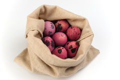 Pink quail easter eggs  in bag on white background Stock Photos
