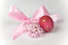 Pink quail egg with flower and ribbon bow  Stock Image