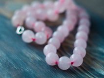 Free Pink Quartz Bracelet On Old Wooden Table. Close Up Royalty Free Stock Images - 86510229