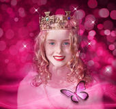 Pink Queen Princess Girl Child. A young girl dressed like a queen wearing a crown with pink tones and a butterfly Royalty Free Stock Photography