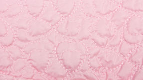 Pink Quilt background. Background texture image of pink quilting with heart shape pattern Royalty Free Stock Photo