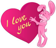 Pink rabbit embraces the heart. I love you Stock Photos