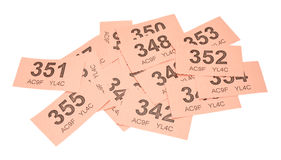 Pink Raffle Tickets. Scattered pink raffle tickets isolated on a white background Stock Photo