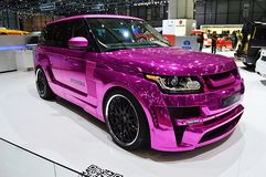 Pink Range Rover Geneva 2013. Geneva, 83th Salon de lAuto 2013 A pink chromed Range Rover is exposed at Mansorys space. The english tuner is well known for royalty free stock photography
