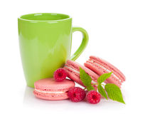 Pink raspberry macaron cookies and cup of drink Royalty Free Stock Image