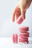 Pink raspberry macaroon at white wooden background Stock Images