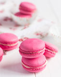 Pink raspberry macaroons on white wooden background Royalty Free Stock Image