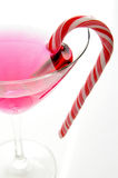 Pink and red. Candycane in a martini glass on white background Royalty Free Stock Images