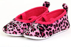 Pink and red baby shoes with a crystal heart on Stock Images