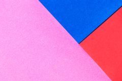 Pink, red and blue color paper display as abstract blank. Background stock photos