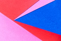 Pink, red and blue color paper display background. Pink, red and blue color paper display as abstract blank background royalty free stock photography