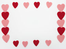 PInk and red felt hearts on white. Red and pink felt hearts on white background. Place in the middle can be used for greeting text or menu for Valentines day stock images