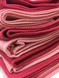 Pink and red fold placemat. A pile of pink and red fold placemat Royalty Free Stock Photo