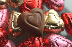 Pink,red, gold foil wrapped heart shape chocolate pieces Royalty Free Stock Image