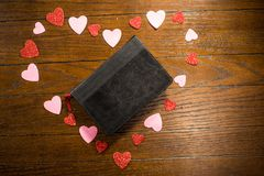 Valentines heart and bible on wooden table royalty free stock photography