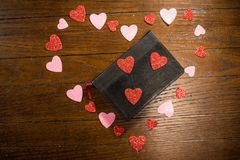 Valentines heart and bible on wooden table royalty free stock photos