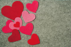 Pink and red hearts on gray felt background Stock Photo
