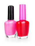 Pink and red nail polish Stock Photos
