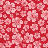 Pink on red random hibiscus flower pattern seamless repeat background. Two colour random hibiscus flower pattern seamless repeat background. Could be used for Royalty Free Stock Images