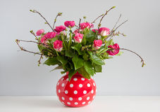 Pink red roses and buttercups Royalty Free Stock Image