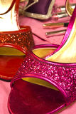 Pink and red shoes. Pink and red glittery shoes Royalty Free Stock Images
