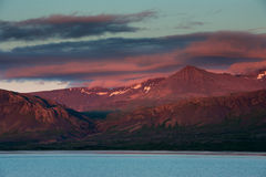 Pink and red sunset on the mountains, Borgarnes, near Reykjavik, Stock Photo