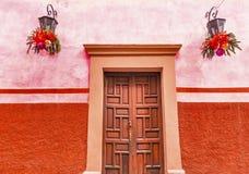 Pink Red Wall Brown Door Christmas San Miguel Allende Mexico. Pink Red Wall Brown Door Christmas Decorations San Miguel de Allende Mexico royalty free stock image