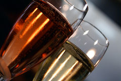 Pink and regular champagne. Shiny lights through two twin glasses of prickly champagne Stock Images