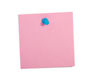 Pink reminder note with blue pin. On white background stock photography