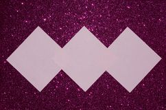 Pink reminder notes on purple glitter background Stock Images