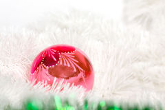 Pink retro ball and Christmas tinsel Stock Images
