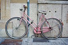 Pink retro bike. About wall stock photos