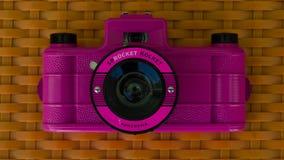 Pink retro camera stock images