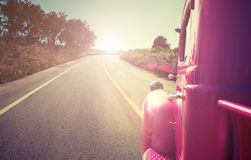 Pink retro car on the road. Travel concept Stock Images