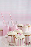 Pink retro dessert table girls birthday party. Pink retro striped theme dessert table at a girls birthday party Stock Image