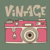 Pink retro film camera icon. Flat vector illustration. Analog photocamera. Vintage inscription. Pink retro film camera icon. Flat vector illustration. Analog Stock Photos