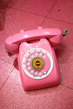 Pink Retro Telephone. A pink old retro telephone on a floor Stock Photos