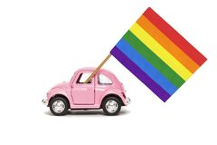 Pink retro toy car delivering bright rainbow gay flag. Concept of gay parade, LGBT community and human rights. Isolated on white royalty free stock image