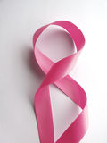 Pink ribbon against cancer  on white background Stock Photography