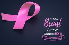 Pink ribbon on black background for supporting breast cancer stock photography