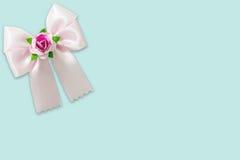 Pink ribbon on blue pastel background Royalty Free Stock Photo