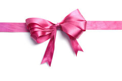 Pink ribbon with bow isolated stock images