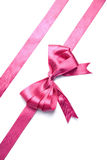 Pink ribbon with bow isolated Stock Image