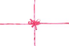 Pink ribbon with bow for present Stock Images