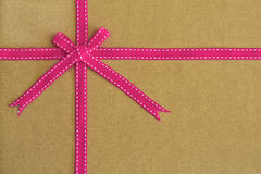 Pink ribbon and bow on recycled card as background Stock Photo